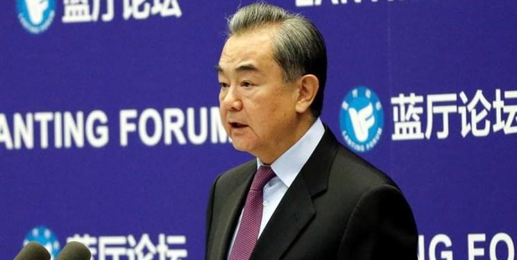 وزیر خارجه چین: برداشتن تحریمهای ایران اولین چیزی است که آمریکا باید انجام دهد